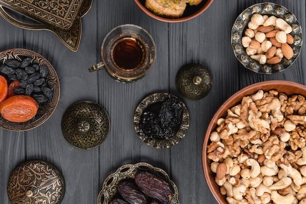 An overhead view of arabian tea; dried fruits and nuts for ramadan Free Photo
