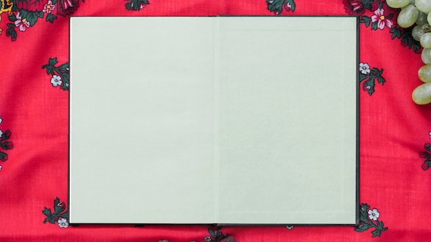 An overhead view of blank notebook on tablecloth Free Photo