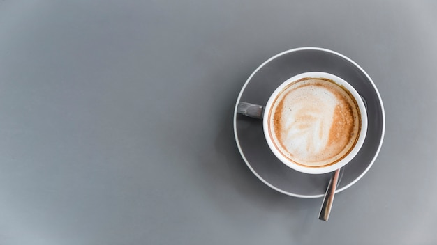 Overhead view of coffee latte on grey background Free Photo