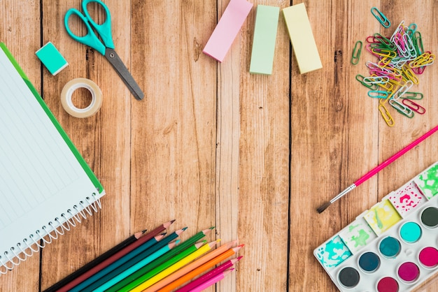 Overhead view of craft accessories on wooden desk Free Photo