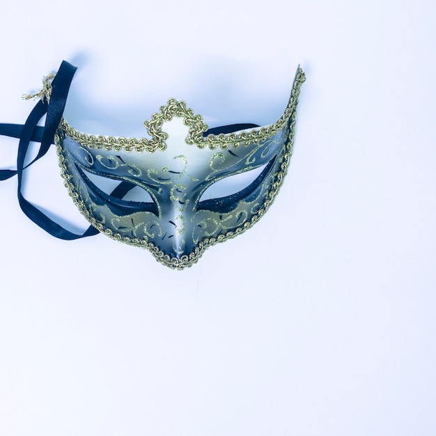 An overhead view of decorative venetian mask on white backdrop Free Photo