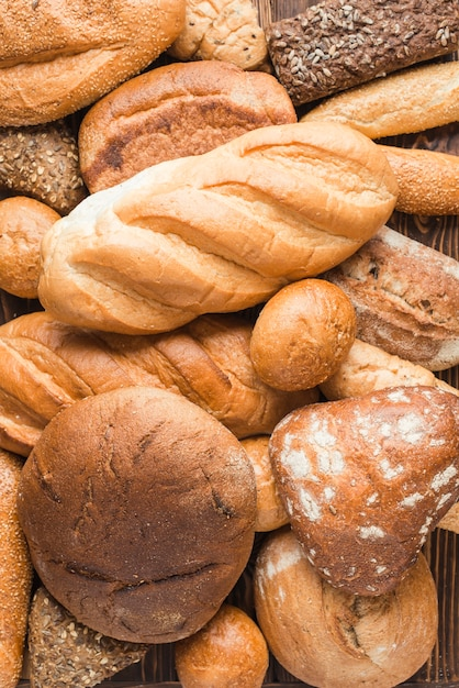 Overhead view of delicious baked breads with various shape Free Photo