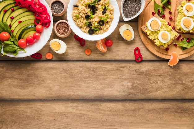An overhead view of different types of healthy foods with boiled egg on table Free Photo