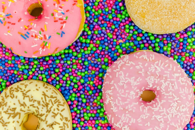 An overhead view of donuts on the sprinkle balls Free Photo