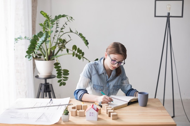 An overhead view of a female real estate agent working in office Free Photo