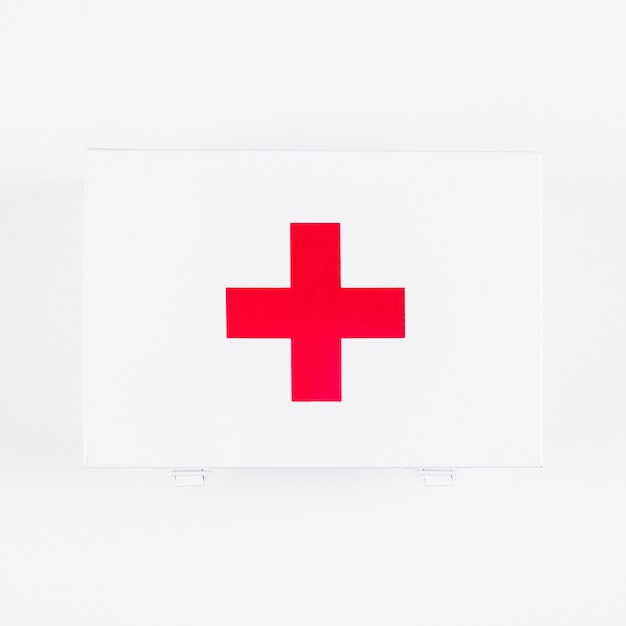 Overhead view of first aid kit with medical sign isolated on white backdrop Free Photo