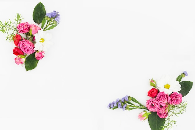 An overhead view of flower bouquet on white background Free Photo