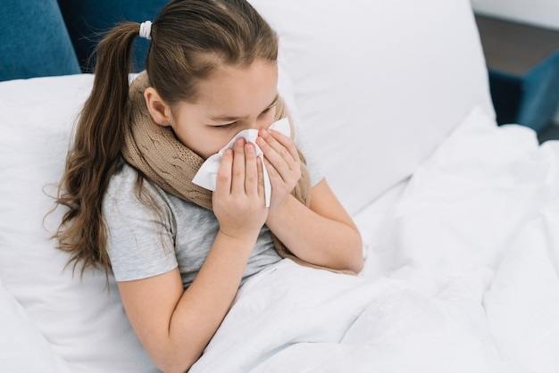 An overhead view of a girl suffering from cold and cough Free Photo
