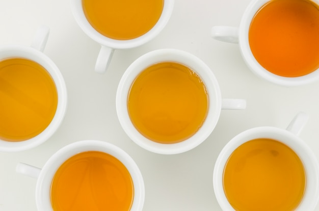 An overhead view of herbal tea cup on white background Free Photo