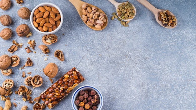 An overhead view of ingredients for making energy bar on concrete background Free Photo