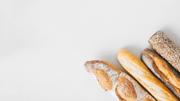 An overhead view of long baguettes isolated on white background Premium Photo