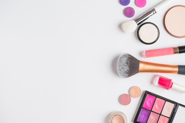 Overhead view of makeup products on white background Free Photo