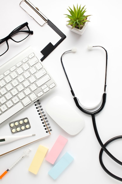 Overhead view of medical accessories on white surface Free Photo
