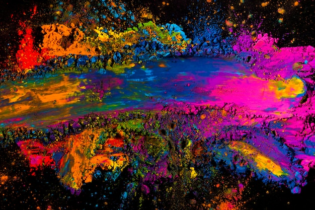 Overhead view of a messy colorful holi color Free Photo
