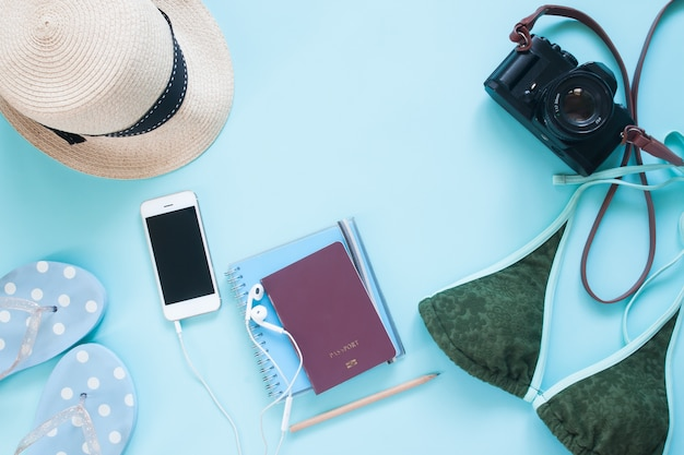 81c6990b3f Overhead view of mobile phone and passport with summer items on blue ...