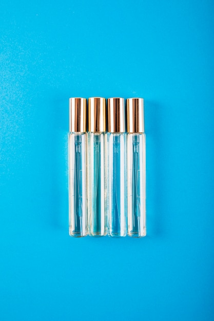 Overhead view of perfume bottles on blue background Free Photo