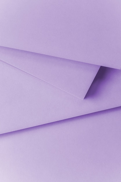 An overhead view of purple paper textured background Free Photo