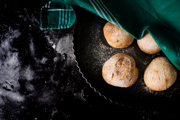 An overhead view of round baked bread on the marble top Free Photo