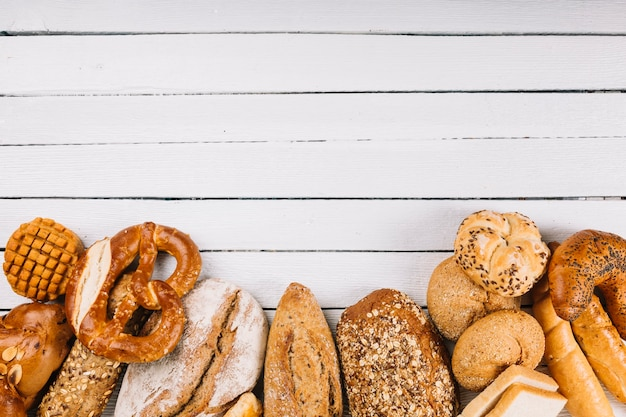 An overhead view of rustic breads on wooden background Premium Photo