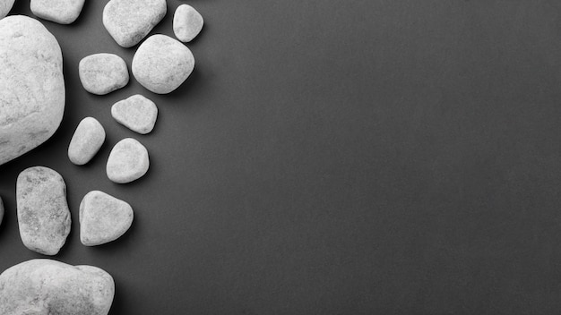An overhead view of spa gray stones on black background Premium Photo