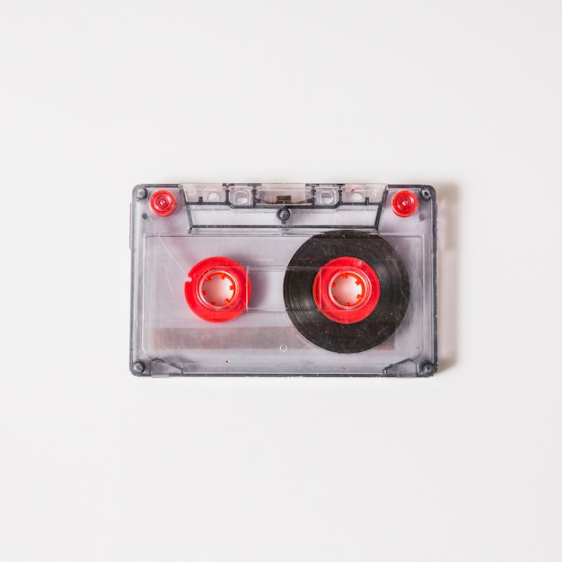 Overhead view of transparent cassette tape on white background Free Photo