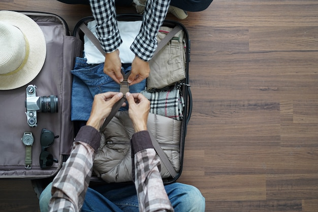 Overhead view of traveler's young couple planning honeymoon vacation trip Premium Photo