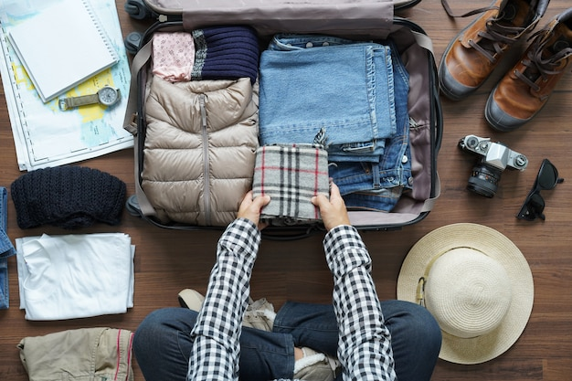 Overhead view of traveler woman plan and backpack planning Premium Photo