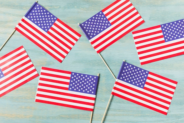 An overhead view of usa flags on blue wooden textured background Free Photo