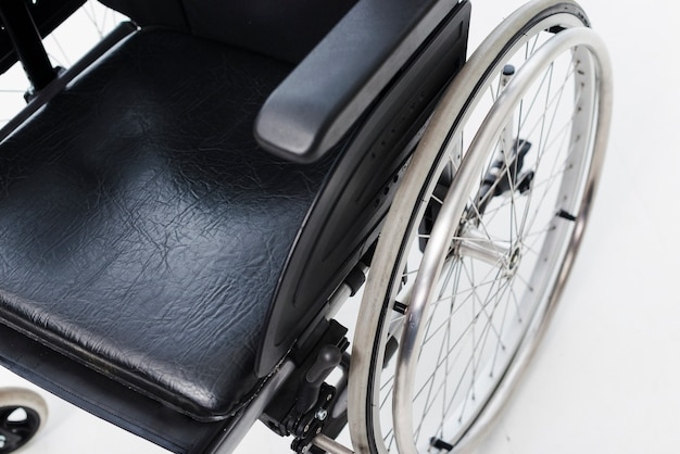An overhead view of a wheelchair on white backdrop Free Photo