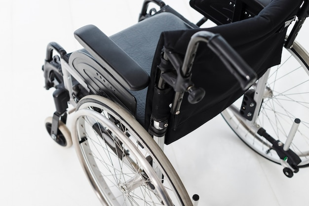 An overhead view of wheelchair on white floor Free Photo