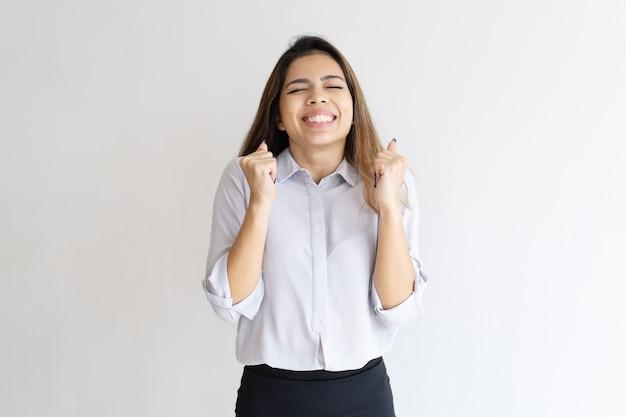 Overjoyed girl hoping for good luck Free Photo