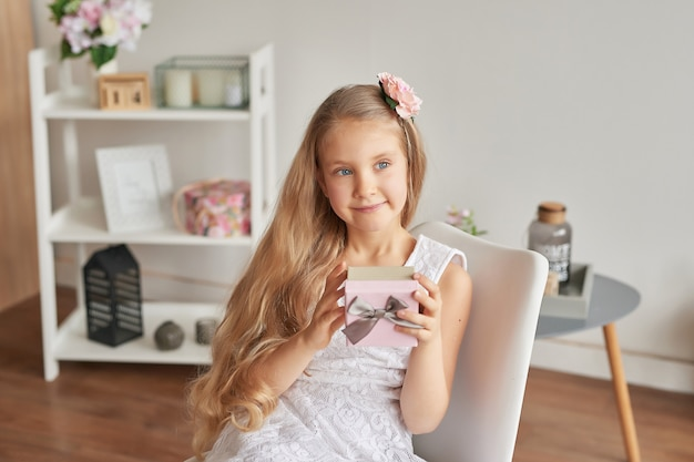 Overjoyed little girl holding present Premium Photo