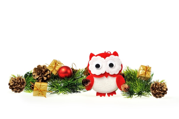 Owl with christmas tree with gifts and cones. Premium Photo