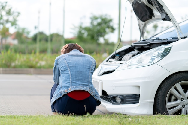 Owner car stressed waiting for car insurance because engine broken Premium Photo