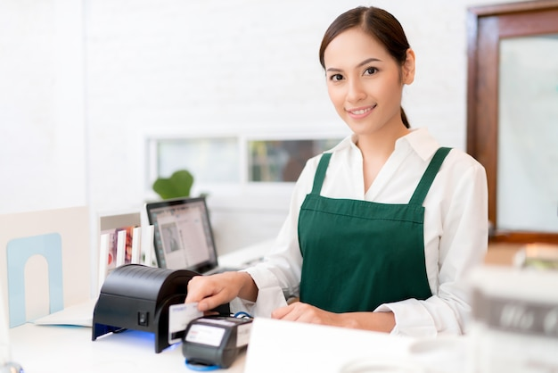 Owner credit card is used to pay for food and coffee. Premium Photo