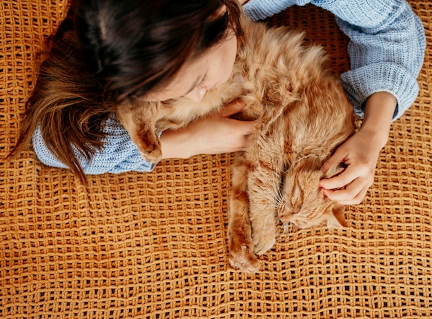 Owner petting adorable cat Free Photo