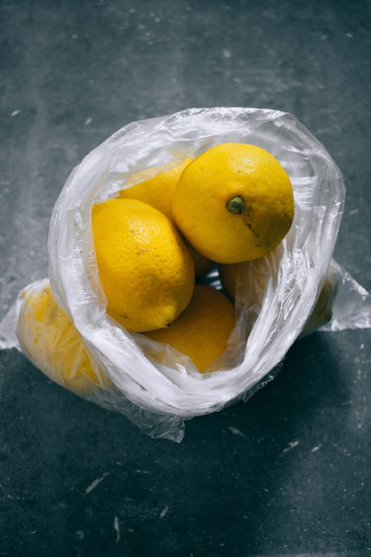 A packet of citrus, lemons on a gray background Premium Photo