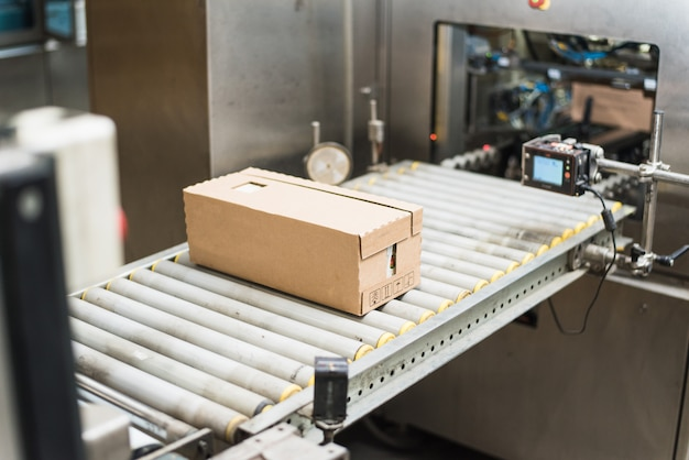 Packing a variety of cardboard products in a cardboard box. work at the factory. without people Premium Photo