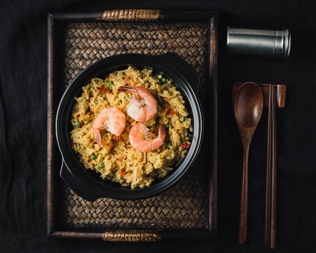 Paella with prawns, traditional spanish recipe Free Photo