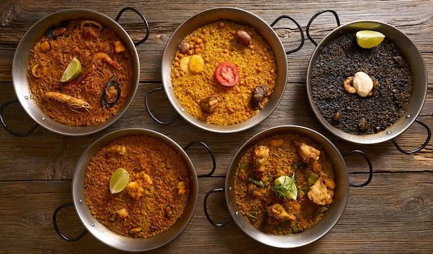 Паэлья пять рецептов риса из испании Premium Фотографии