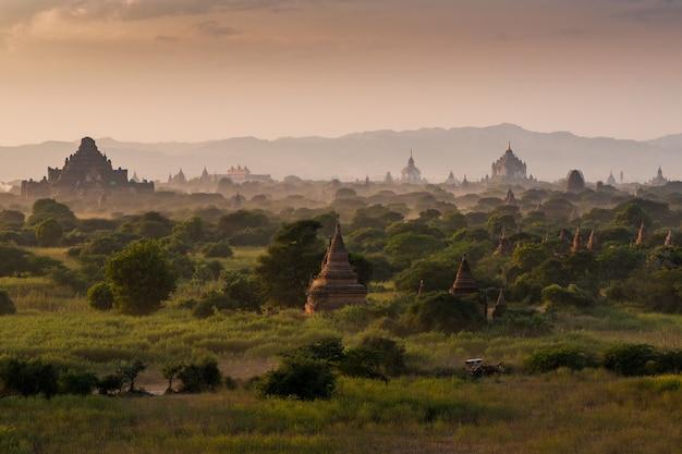 Pagoda landscape under a warm sunset in the plain of bagan, myanmar (burma) Premium Photo