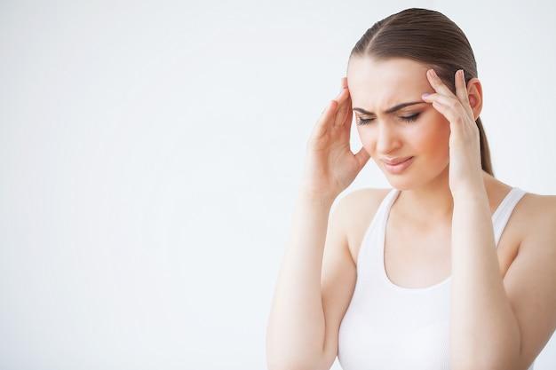 Pain. portrait of a young woman has a headache Premium Photo