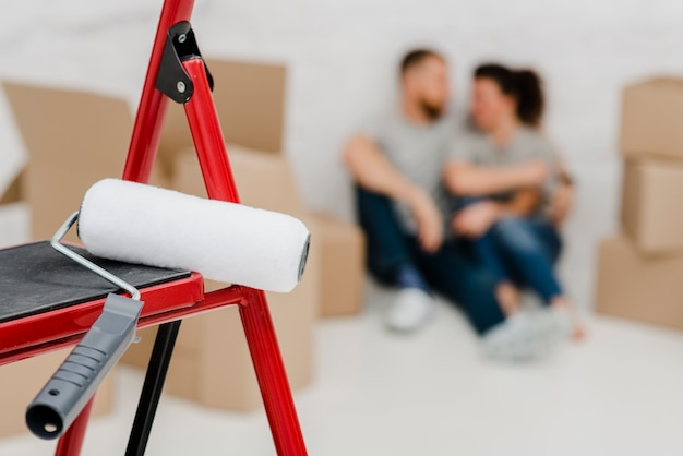 How To Use A Paint Roller On A Ladder