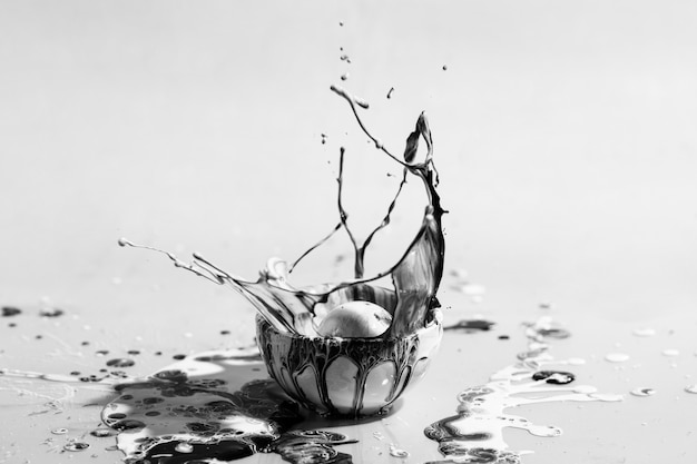 Paint in small cup grayscale Free Photo