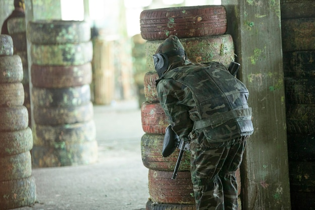 Paintball player in soldier outfits. Free Photo
