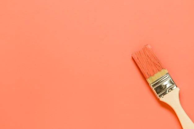 Paintbrush on orange background Free Photo
