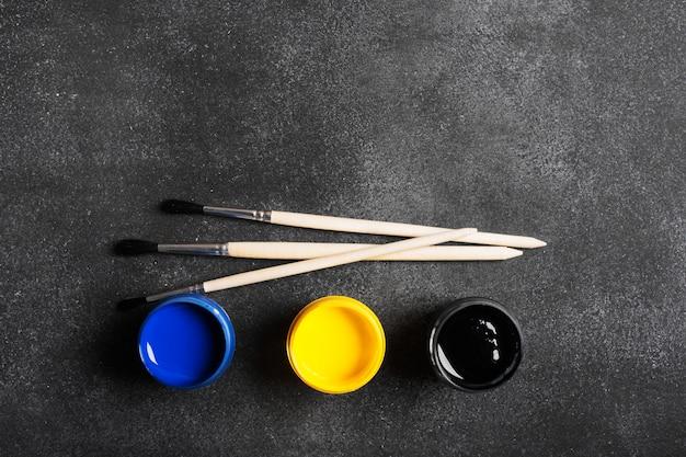 Paintbrushes and paints Premium Photo