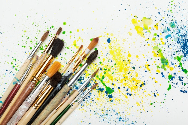 Paintbrushes and water-color abstract art close up Premium Photo