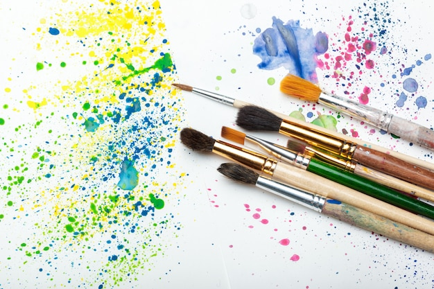 Paintbrushes and watercolor abstract art Premium Photo