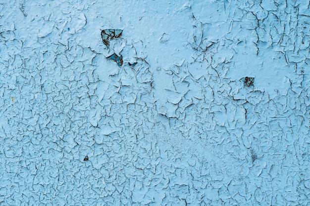 Fondo o struttura blu del metallo verniciato del grunge con i graffi e le crepe Foto Gratuite